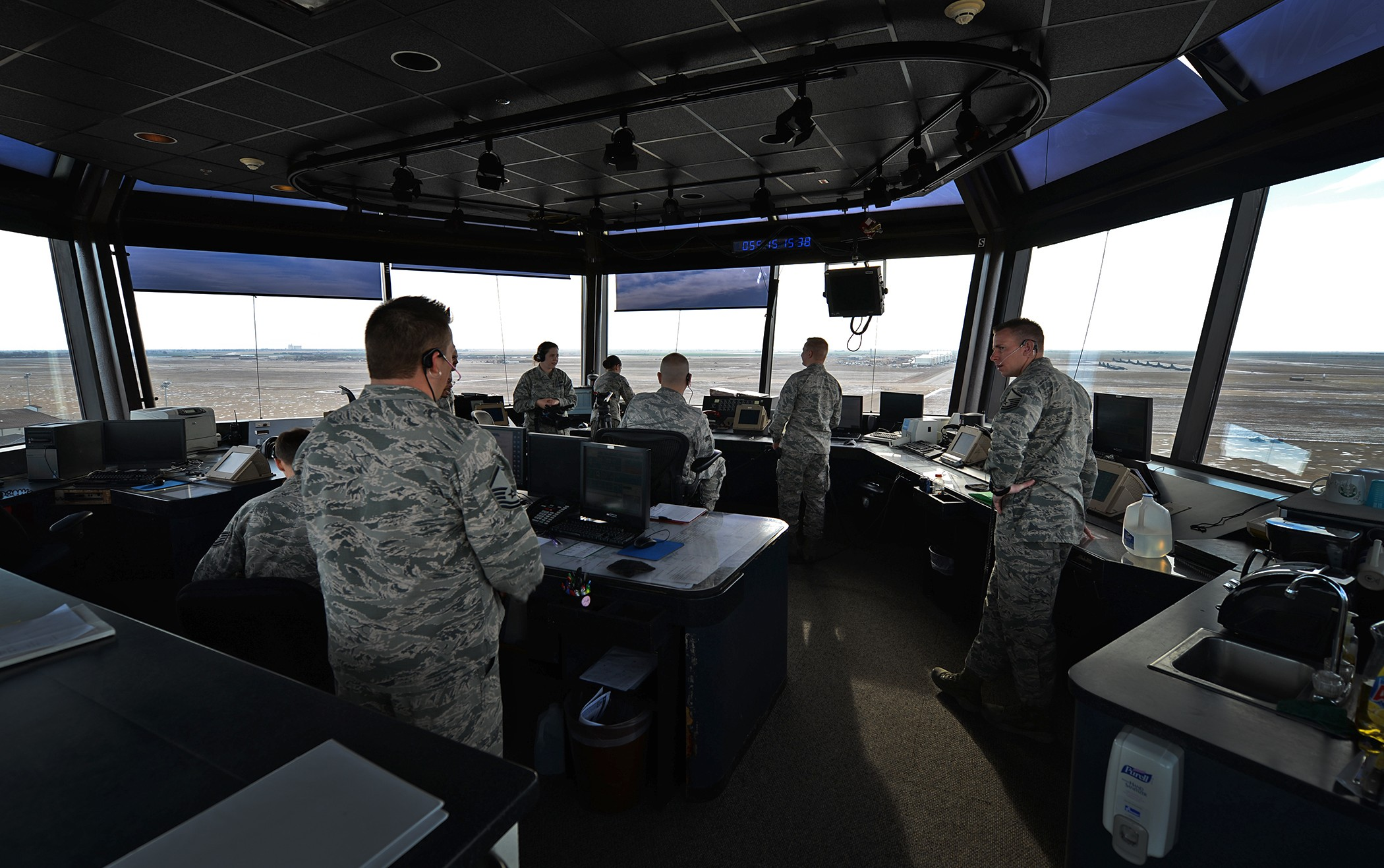 Members of the 27th Special Operations Support Squadron air traffic control man the tower and maintain constant communication with aircraft Feb. 24, 2015, at Cannon Air Force Base, N.M. The men and women of the 27th SOSS ensured that 2014 was the safest year in aviation and are striving to continue that momentum. (U.S. Air Force photo/Airman 1st Class Chip Slack)